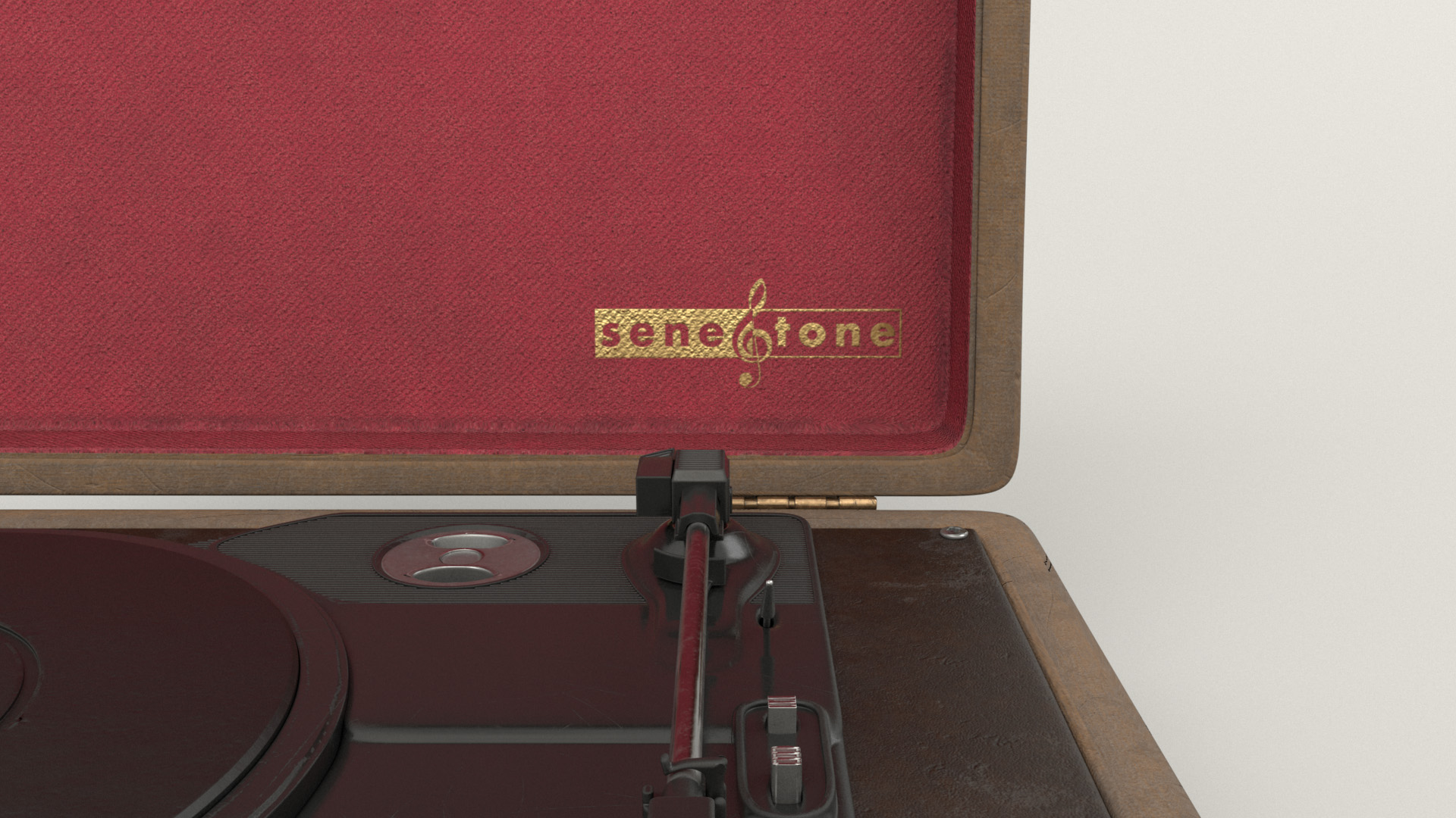 """Figure 21: Close-up of the red fabric briefcase liner and gold """"SeneTone"""" logo."""